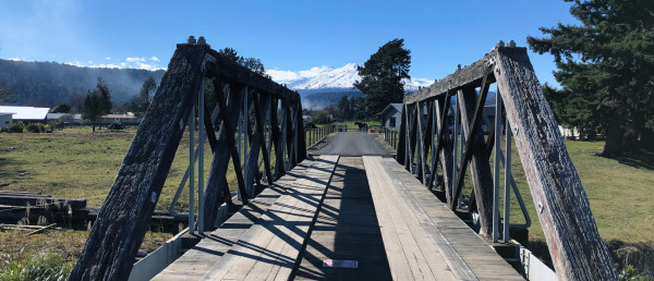 A bridge with Mount Ngauruhoe in the distance